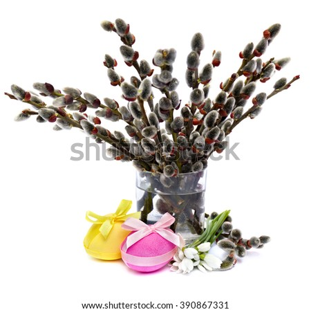 Easter decoration. Willow branch, snowdrop and Easter eggs on white background. - stock photo
