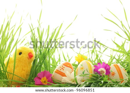 Easter decoration with chick and eggs on fresh green grass - stock photo