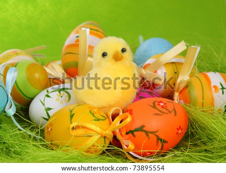 Easter decoration with chicken and plastic eggs - stock photo