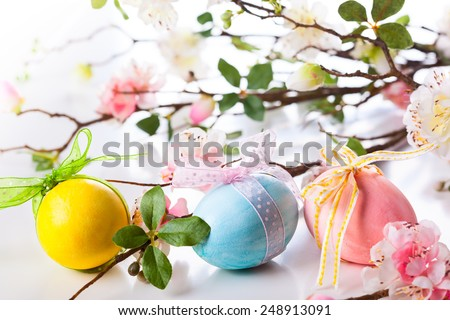 Easter decoration with eggs and spring flowers - stock photo