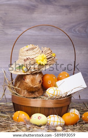 Easter decoration with eggs on a wooden background