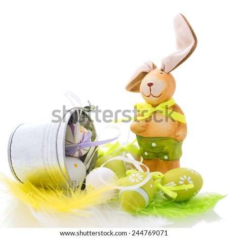 Easter decoration with rabbit and eggs on white background - stock photo