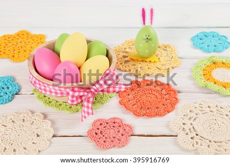 Easter decoration with rabbit and eggs on wooden 