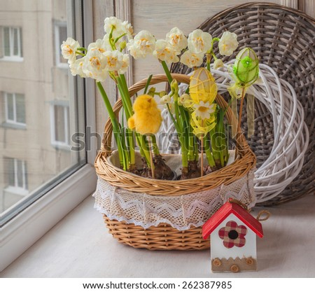 Easter decoration with white daffodils blooming balcony - stock photo
