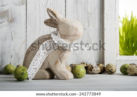 Easter decoration, wooden easter bunny and quail eggs