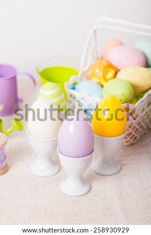 Easter decorations - egg candles, basket and birdhouse