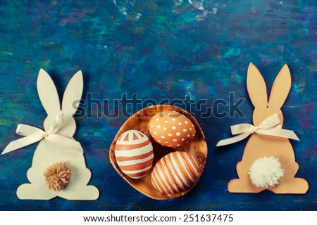 Easter decorations, painted eggs and Easter bunnies cutting out paper - stock photo