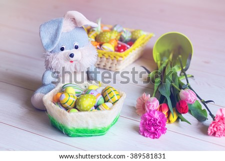 Easter decorations with flowers and toy - stock photo
