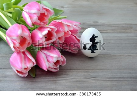 Easter. Easter background with easter eggs  and red tulips. Copy space, for easter text. Easter card, easter flower. Easter eggs for easter nest.  - stock photo