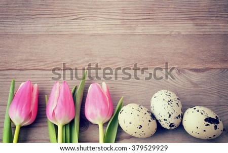 Easter. Easter background with easter eggs and red tulips.Easter tulips. Easter.  Copy space, for easter text. Easter holiday. Easter card, easter flower. Easter eggs for easter nest. Easter.  - stock photo