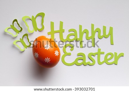 Easter egg and paper inscription on white background - stock photo