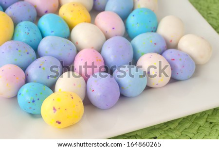 Easter Egg Candy in a Square White Dish on a Table.  Closeup horizontal. - stock photo