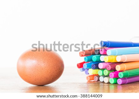 Easter Egg Chickens and color pen on wooden table