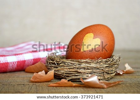 Easter egg colored naturally with onion peel - stock photo