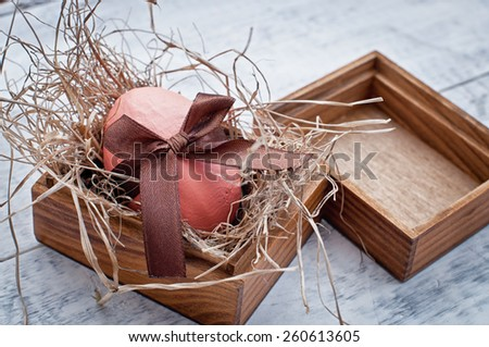 easter egg decoration on wooden background - stock photo