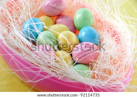 Easter egg filled with chocolate candy - stock photo