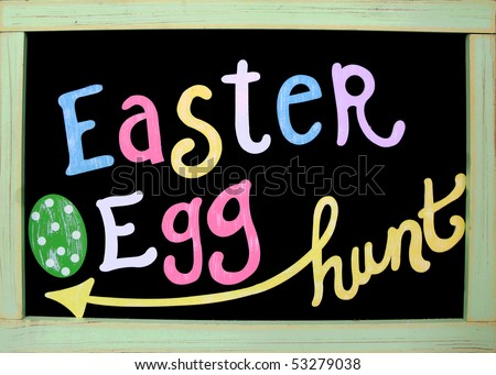 easter egg hunt handwritten on board in pastel colors - stock photo