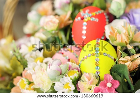 easter egg in basket of flowers - stock photo