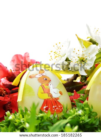 Easter egg in fresh green grass - white background - stock photo