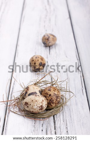 Easter egg nest on rustic wooden background - stock photo