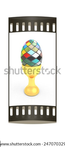Easter egg on gold egg cups on a white background. The film strip - stock photo