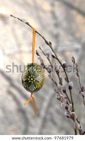 Easter egg on pussy willow - stock photo