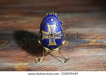 Easter egg on rustic wooden table background - stock photo
