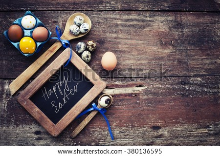 Easter egg over wooden surface - stock photo