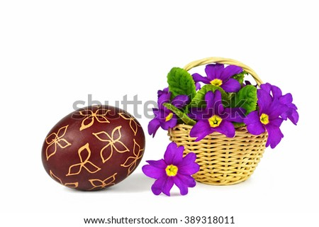 Easter egg painted with wax and spring flowers isolated on white background - stock photo