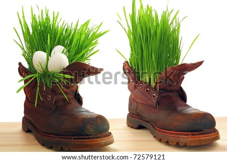 Easter egg, spring and force of nature. Spring comes everywhere, even in the old soldier's boot. Nothing donâ??t stop  forces of nature - stock photo