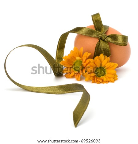 Easter egg with festive bow isolated on white background - stock photo