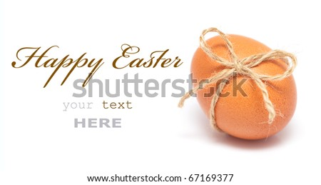 Easter egg with festive bow isolated on white background (with space for text) - stock photo