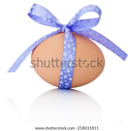 Easter egg with festive purple bow isolated on white background - stock photo
