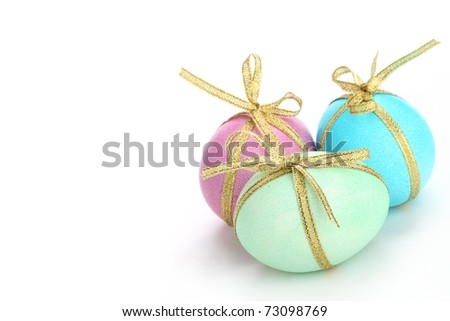 Easter egg with golden bow isolated on white. - stock photo