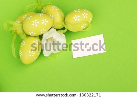 Easter egg with tulips with card for your text - stock photo
