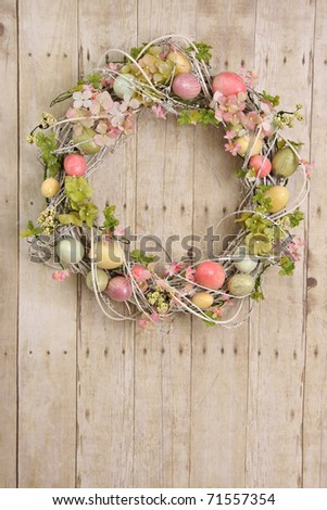 Easter egg wreath on a wooden background. Also available in horizontal. - stock photo