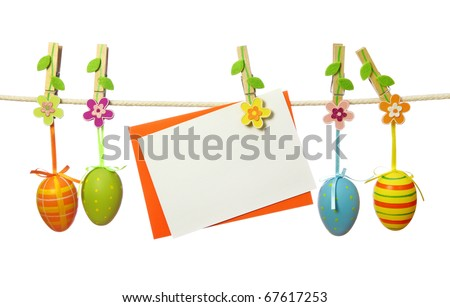 Easter eggs and blank note hanging on the clothesline isolated on white background - stock photo