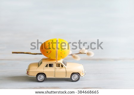Easter eggs and catkins on car abstract retro concept