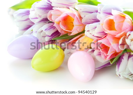 easter eggs and colorful  tulips on the white background