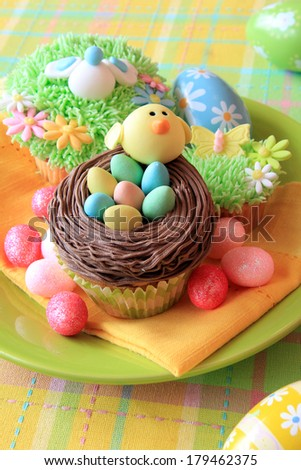 Easter eggs and Easter cupcakes - stock photo