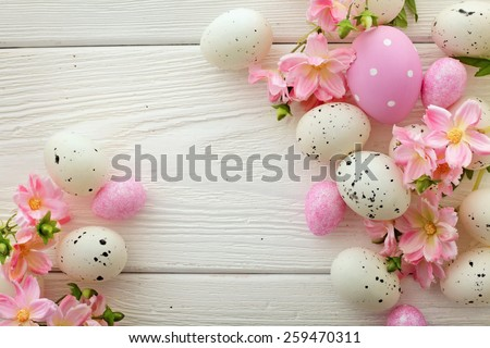 easter eggs and flowers frame background - stock photo