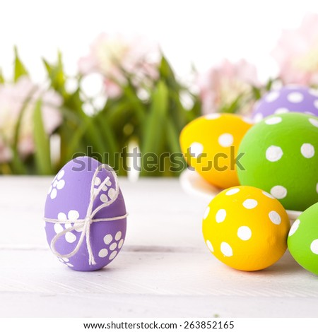 Easter eggs and Fresh Green Grass on White Background - stock photo