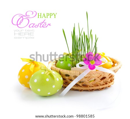 Easter eggs and green sprouts are in a basket on a white background - stock photo