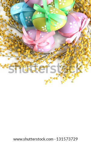 Easter eggs and mimosa flowers, isolated on white - stock photo