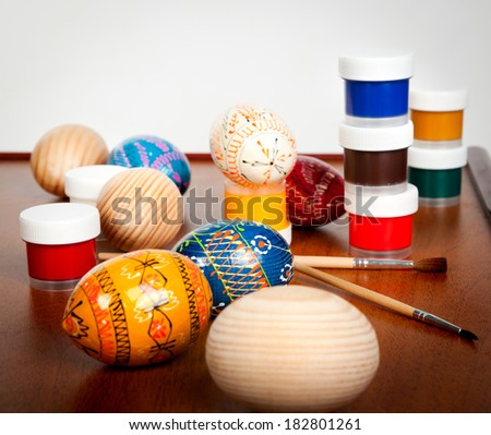 easter eggs and paint on the table - stock photo