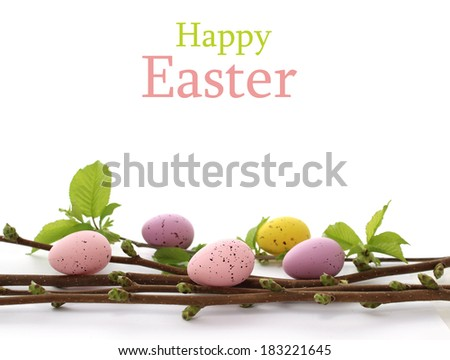 easter eggs and spring branch isolated on white - stock photo