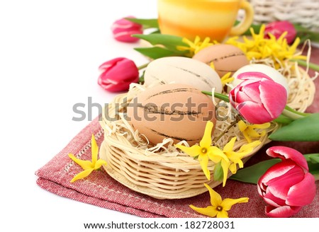 Easter eggs and spring flowers - stock photo