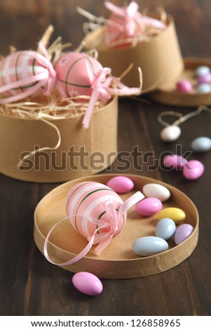 Easter eggs and sugar coated candy eggs in the gift paper box