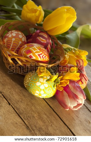 Easter eggs and tilips - stock photo