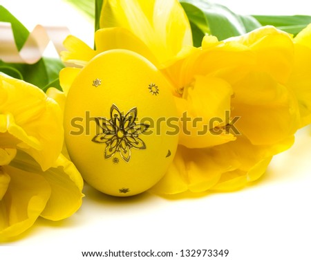Easter eggs and tulips - stock photo